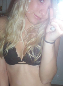 Teen Strips Out Of Her Clothes To Just Her Black Lace Bra And Panties - Picture 5